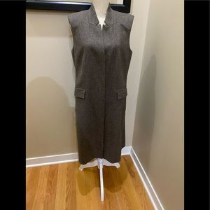 Worth NY sleeveless dress with fine details.